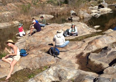 Hikers rest on rocks in the Temecula Gorge