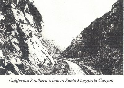 railroad track curving left through canyon