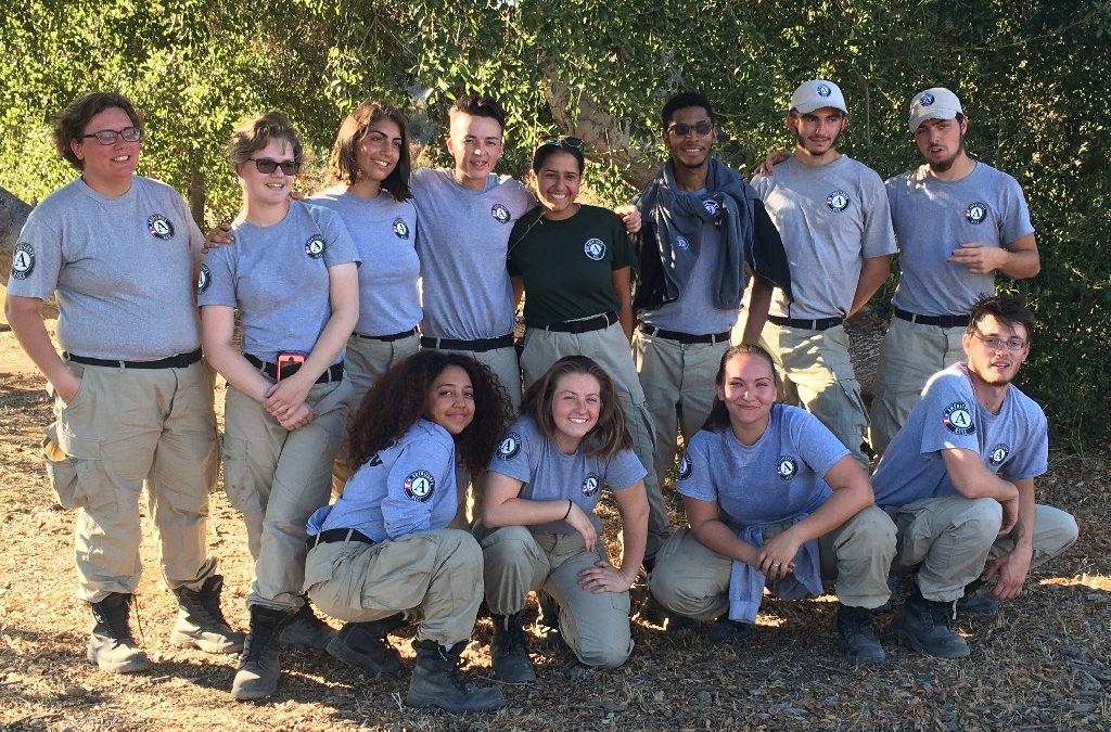12 youth together wearing the AmeriCorps uniforms